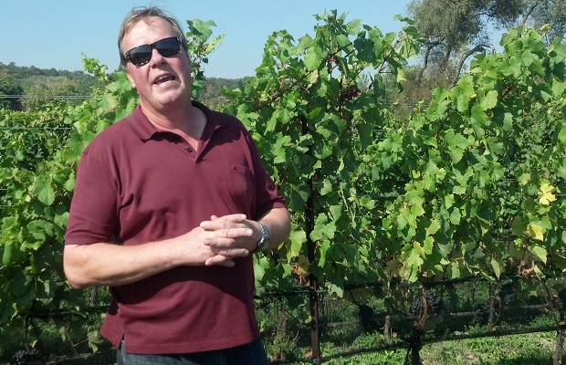 Harald Thiel in front of Pinot Noir vines in the Felseck Vineyard