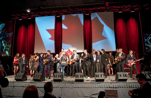 Candian musicians and atheletes sing O Canada at Gold Medal Plates Toronto 2014 (c) Ronald Ng Photography