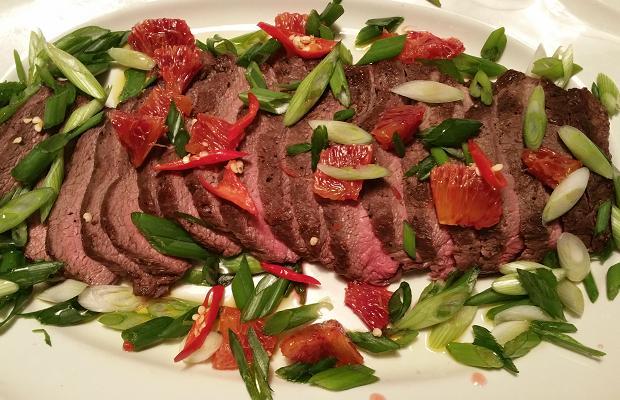 Flat Iron steak, blood orange, scallion and chile
