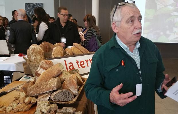 Konrad Ejbich holding court in front of De La Terre's breads