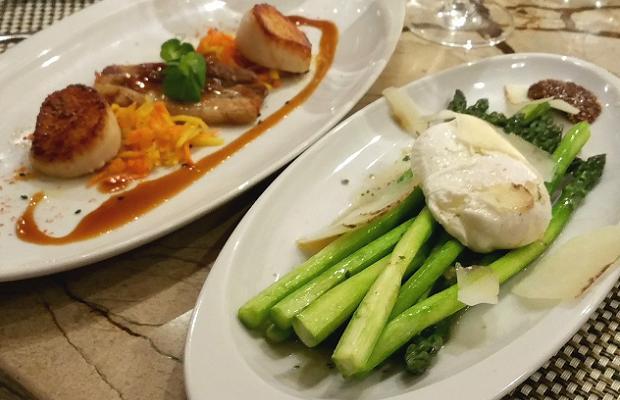 "Treadwell's Pan Seared East Coast Scallops, caramelized cauliflower, guanciale, caper vinaigrette and Ontario Asparagus, poached ""Bertha's Bounty"" egg , truffled burnt butter vinaigrette"