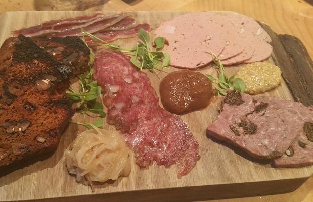 Le Caveau's Charcuterie Plate, house-made and locally sourced, served with chutney, shallot compote and spiced bread